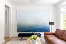 large photo of the ocean in simple living room