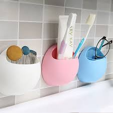 suction cup at the back of the toothbrush holder helps stick in the mirror glass refrigerator etc