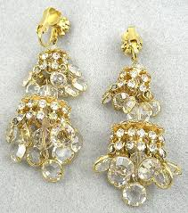 description vintage rhinestone and crystal gold tone chandelier clip earrings these truly are miniature chandeliers with two tiers of hanging clear