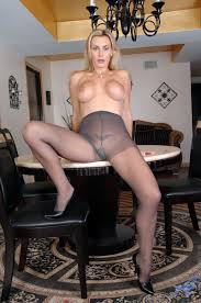 Frisky big boobed blonde Tanya Tate shows off her ass in gray.