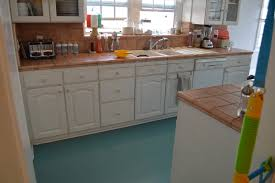 charming traditional white kitchen design with two tone kitchen cabinets as well as vintage style teal varnished linoleum flooring inspirations