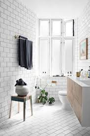 copenhagen calling inside it pernille teisbaek s new home white tiled bathroom