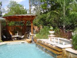 Swimming Pool:Impressive Small Backyard Pool Landscaping With Neutral  Waterfall And Wooden Canopy Idea Impressive