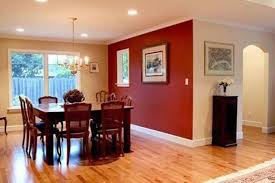 living room ideas with red accent wall. blue ottoman as coffee table living room accent wall brown tile. red ideas with