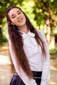 It's become a *thing* for the gen z kids to wear their hair with a middle part, and only a middle part. Nominated Portrait Of A Cute Young Girl With Long Brown Hair With A Beautiful Smile One Person Young Adult Young Women Real People Lifestyles Beautiful Woman Leisure Activity Hairstyle Hair Outdoors Brown