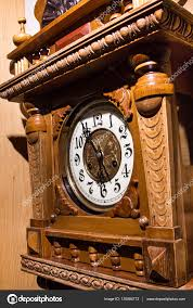 old wooden wall clock stock photo