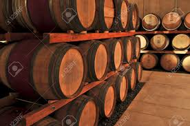 oak wine barrels. stacked oak wine barrels in winery cellar stock photo 4687997