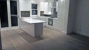 pure white caesarstone quartz kitchen worktops with brown glass splashbacks chiswick