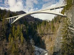 take it to the bridge  in 1930 swiss officials chose this design for the salginatobel bridge because it was the cheapest of 19 submissions simpson found a plaque which said that