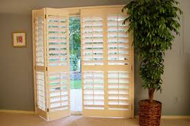 wooden plantation shutters can be installed over a sliding glass door