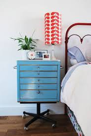 bedrooms vintage bedroom with comfy bed near blue vintage nightstand also red table lamp bedside
