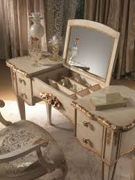 antique modern makeup vanity table with 4 drawer and painted with white color plus makeup storage under fold up mirror and french style chair with fabric