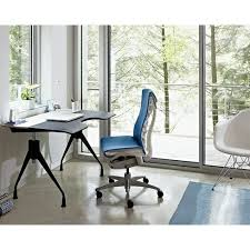 herman miller home office. a home office with treetop view the interior features herman miller envelop desk embody chair and eames molded plastic armchair