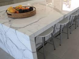 calacatta marble kitchen waterfall: polished calacatta marble kitchen bench with honed azul limestone floor tile
