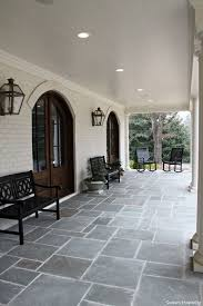 Modern patio floor Concrete Modern Farmhouse Atlanta004 Two Arched French Doors Lead Into The Dining Room From The Front Porch Caddetails Feature Friday Modern Farmhouse In Atlanta Exterior Pinterest