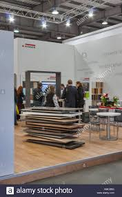 Visitors visit Egger wooden furniture pany booth during Kiev