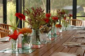 Adorable Table Christmas Decoration With Chic Glass Vase Flowers Place At  Rustic Woods Dining Table For Christmas Table Arrangements Ideas