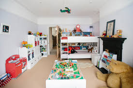georges bedroom age 3 example of a classic kids room design for boys in london with all white furniture design