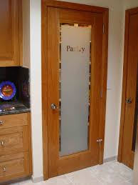 frosted art glass storage door with brown wooden frame inside pantry on cream tile floor interior ideas