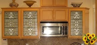 we cut out the center panels of the cabinet doors and replaced them with the above leaded glass panels we used nf bevel cers in the center and