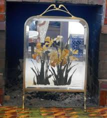 a great victorian fireplace screen but why not use it to conceal unwanted wires and clutter