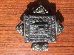 antique tibetan gau buddhist prayer box pendant has small inset turquoise stones