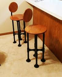 dan built these bar stools because he wanted a few stools to accompany the open counter in his kitchen and to be able to watch tv from the space while