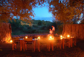romantic outdoor dining room decoration with candle light