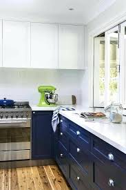 blue kitchen cabinets navy lower with white quartz colored images