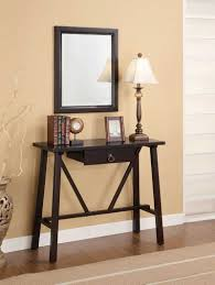 Very Narrow Modern Wood Console Table With Drawer Under Wall Mounted Mirror  With Frame Painted With Brown Color For Narrow Hall Spaces Ideas