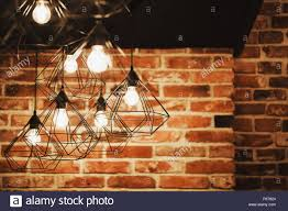 The Brick Lighting Geometry Lamps In Loft Interior Over The Brick Wall Stock