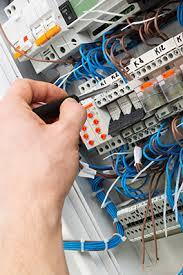 for commercial and industrial lighting installations hayle an electrician testing a fuse box