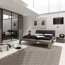 rug under bed hardwood floor. Rug Bedroom Large-size Modern Round Rugs And Black On Gray Floors Combined With White Moroccan Under Bed Hardwood Floor