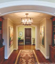 luminous natural camelhair of an antique serab runner transforms houston home s passageway into a destination
