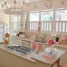 comely vintage small kitchen design ideas with white marble countertop and cream cabinet also black iron cooktop over antique chandelier complete under
