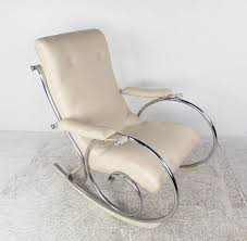 this sleek modern rocking chair features a tufted vinyl seat with stylish chrome frame mounted