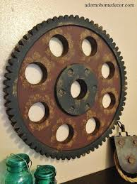this decorative metal gear wall art is a must have for home decor this unique industrial look gear is complete with holes and teeth