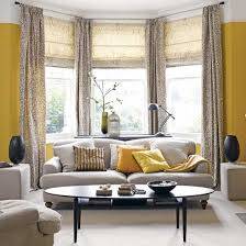 traditional style living room with yellow painted walls