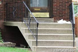 concrete stairs and porch with metal
