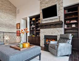 eldorado nantucket stacked stone living room transitional with tv above fireplace beige etageres5
