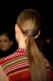 it was seen on the chanel runways but in truest form at the lam show the ponytail holders look fab with the long sleek low ponytail style of the