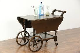 oak tea cart or beverage trolley 1930 vintage photo