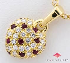 star jewelry heart motif ruby diamond 18 karat gold yellow gold pendant necklace 2200000263544