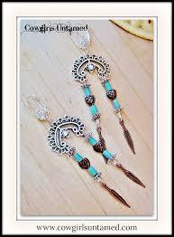 southwestern cowgirl style earrings copper feather charm heart beads with aqua raku on antique silver chandelier and rhinestone western earrings