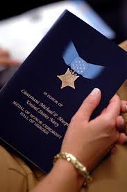 u s department of defense photo essay an attendee holds the medal of honor award program during a ceremony recognizing the actions of