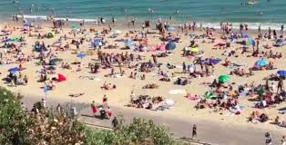 First time i ever saw an ocean was flying over it. Bournemouth Beach Flooded With Tourists On Hottest Day Of The Year