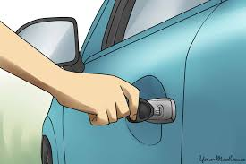 how to disable a car alarm yourmechanic advice person putting key into drivers side door