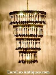 upcycled chandelier crafted with 360 vintage silverplate spoons