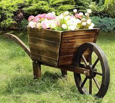 rustic wood wheelbarrow planter decoration