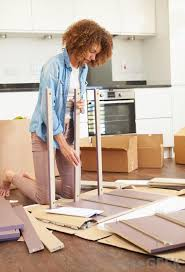 what is flat pack furniture. woman assembling furniture what is flat pack wisegeek